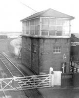 The signal box at Longtown on the Waverley route circa 1962. The view is south from the station footbridge over the level crossing with the single line to Gretna and Mossband Junction branching off to the right. This line was used latterly to give southbound freight traffic off the Waverley a direct route into Kingmoor yard. [Railscot note: <I>Rescued</I> image.]<br><br>[Robin Barbour Collection (Courtesy Bruce McCartney)&nbsp;//1962]