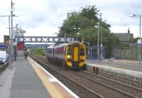 158 715 for Inverness calls at Dyce on 15 June. My photography appears to be attracting the frank curiosity of the chap on Platform 2.<br><br>[David Panton&nbsp;15/06/2009]