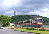 An SPT liveried 170 rounds the bend towards the Wallace Monument on 18 June with a service for Alloa.<br><br>[David Forbes&nbsp;18/06/2009]