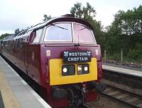 D1018 diesel hydraulic <i>Western Champion</i>, held at Carrbridge on the evening of 19 June with the <i>Western Chieftain</i> Bristol to Kyle railtour, waiting to cross the Inverness portion of the Caledonian Sleeper.<br><br>[Gus Carnegie 19/06/2009]