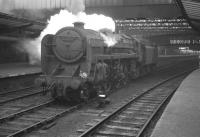 BR Standard class 6 Pacific no 72007 <I>Clan Mackintosh</I> stands on the centre road at Carlisle in April 1964 waiting to take over the 9.25am Crewe - Perth train.<br><br>[K A Gray&nbsp;11/04/1964]
