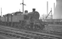 Fowler 3P 2-6-2T no 40070 stands in a siding at Willesden in 1959, near the end of its operational life. The locomotive was officially withdraw in March the following year and cut up at Derby works 2 months later.<br><br>[K A Gray&nbsp;//1959]