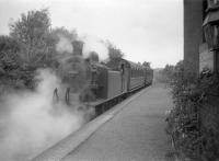 First stop on the West Highland line for the Craigendoran - Arrochar push-pull train was Helensburgh Upper. 67474 is seen leaving the station with the northbound service on 29 July 1959.<br><br>[Robin Barbour Collection (Courtesy Bruce McCartney)&nbsp;29/07/1959]