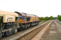 EWS 66017 takes a train of Lafarge aggregates south on the Midland Mail line through Sileby on 22 June.<br><br>[Peter Todd&nbsp;22/06/2009]