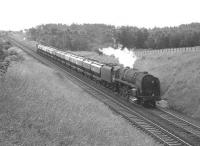 A 9F 2-10-0 with a northbound cement train near Braidwood on Glasgow Fair Saturday in July 1966.<br><br>[Colin Miller&nbsp;/07/1966]