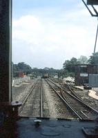 Second man's window view at Dorchester South in May 1985 as a Weymouth bound train approaches the station. Note the ex-SR signal box on the right.<br><br>[John McIntyre&nbsp;/05/1985]