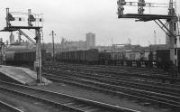 View from the end of Platforms 3 & 4 at Aberdeen into Guild Street Yard at a time when the yard was open and railfreight was plentiful, 20 February 1977. The container yard can be seen below the signal on the right.<br><br>[John McIntyre 20/02/1977]