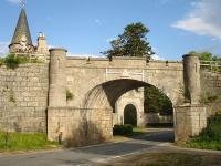 Rail Overbridge and gatehouse to the north of Grantown on Spey, where the former Forres line crosses the A939 road. A private halt was provided here by the Inverness and Perth Junction Railway in 1863  <I>...in acknowledgement of the great facilities given by the Earl of Seafield in the formation of the railway through his estates.</I><br><br>[David Pesterfield&nbsp;26/06/2009]