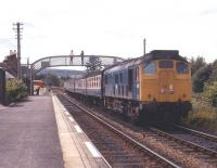 Northbound train behind a type 2 at Lairg in August 1972<br> <br><br>[Colin Miller&nbsp;/08/1972]