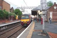 A Helensburgh Central service arrives at Coatbridge Sunnyside on 1 July 2009.<br><br>[John Steven 01/07/2009]