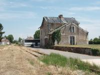 Many French station buildings survive as private residences, on both closed and open lines. Cozes however, on the former Saujon to Pons line, has not been so fortunate and is crumbling away despite being a very interesting looking building. The tracks are still in place from Saujon to Gemozac, with a passing loop here, but it is a long time since any rail traffic passed this way and the local buses are now stabled encroaching onto the track.  <br><br>[Mark Bartlett&nbsp;25/06/2009]