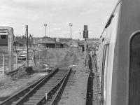 View from the BLS <I>Lothian and Fife Wanderer</I> DMU railtour on 23 August 1980 as it passes the truncated siding into Leith Walk East goods (latterly a parcels depot) on the way to Granton.<br><br>[Bill Roberton&nbsp;23/08/1980]