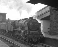 Rebuilt <I>Patriot</I> 4-6-0  no 45545 <I>Planet</I> stands with what is thought to be the 9.43am Liverpool - Glasgow Central train at the north end of Carlisle station in April 1963. The locomotive was transferred from Crewe North to Upperby 12 months earlier and stayed until finally withdrawn by BR in 1964. Disposal was via Connels of Coatbridge in September of that year.<br> <br><br>[K A Gray&nbsp;12/04/1963]