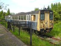 Railbus prototype no 140001 stored west of Dufftown station in June 2009. The track ends just ahead of the unit and the trackbed is then blocked by an access road into the adjacent distillery complex. [See image 24656]<br><br>[David Pesterfield&nbsp;26/06/2009]