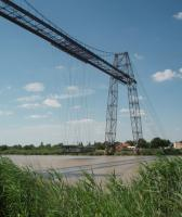 Similar in operation to, but 11 years older than, its Middlesbrough counterpart [See image 59948] this is Rochefort transporter bridge over the River Charente. Built in 1900 it has been replaced by a motorway viaduct in recent years but still operated by the local government region as a preserved industrial monument.<br><br>[Mark Bartlett&nbsp;24/06/2009]