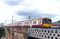 A 318 emu heads west along Yorkhill viaduct on 5 July 2009.<br><br>[Colin Miller&nbsp;05/07/2009]