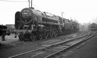 Britannia Pacific no 70002 <I>Geoffrey Chaucer</I> sporting a 31B, March, shedplate stands at the north end of Doncaster shed in the summer of 1962, possibly following a visit to the nearby works.<br><br>[K A Gray&nbsp;28/07/1962]