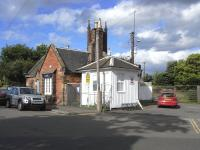 Surviving buildings at the entrance to the former goods yard alongside Dunbar station, photographed on 18 June 2009. The white wooden structure was probably the coal office.<br><br>[David Panton&nbsp;18/06/2009]