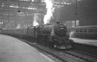 Scene at Edinburgh's Princes Street station in May 1964 as snowplough-fitted Black 5 no 45126 prepares to leave with the 3-coach 1.20pm service to Lanark.<br><br>[K A Gray&nbsp;18/05/1964]
