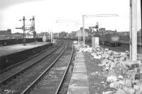 View east from the platforms at Gilmour Street station in June 1966 with electrification work well underway. In the background a pair of Claytons can be seen passing Wallneuk Junction signal box with a westbound freight on the Ayr line.<br><br>[Colin Miller&nbsp;/06/1966]