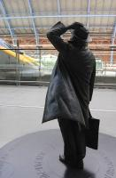 The Martin Jennings bronze statue of the late Sir John Betjeman, hand on hat, gazing up at the legacy of William Henry Barlow from the concourse of St Pancras station on 5 July 2009. <br> <br><br>[Bill Roberton&nbsp;05/07/2009]