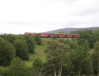 The <I>Marco Polo</I> special charter train approaching Carrbridge on 9 July taking passengers off the stricken cruise liner from Inverness to Kings Cross. [Bus links were organised from Invergordon Port to Inverness and from Kings Cross to Tilbury.] <br> <br><br>[Gus Carnegie 09/07/2009]