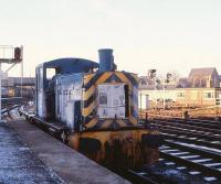 Scene at Hull station on a freezing cold January morning in 1980. Station pilot 03063 takes time out during a quiet period to catch up with the morning's news.<br><br>[Peter Todd&nbsp;02/01/1980]