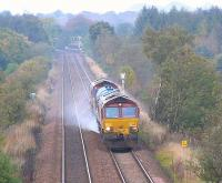 A <i>Railhead treatment train</i> approaches MidCalder Jct with Livingston south station in the background in October 2005<br><br>[James Young&nbsp;15/10/2005]