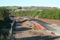 The temporary road from the site of Polkemmet Jct to bypass the overbridge on the Whitburn Road takes shape in late May 2009. <i>Bathgate Academy</i> in the background.<br><br>[James Young&nbsp;30/05/2009]