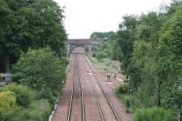 View East from the B792 overbridge as electrification masts and Stop boards for shunting moves appear. The overbridge in the distance will shortly be rebuilt for electrification. To the right is the headshunt for the now mothballed <i>STVA yard</i>. <br><br>[James Young&nbsp;08/07/2009]
