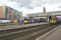 A busy scene at Manchester Oxford Road on 8 July 2009 with three trains waiting to depart. From Left to right a Class 142 in the bay platform waits to head to Liverpool with a stopping service. Next is a Class 150 on the rear of a service to Manchester Airport with another Class 142 leading. On the right is a service to Barrow.<br><br>[John McIntyre&nbsp;08/07/2009]