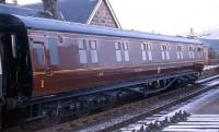 12 wheel 1st Class sleeping car built at Wolverton in 1952 to LMS design, lot 1584 and numbered M394M stands at Boat of Garten in 1973 having been preserved in LMS livery.<br><br>[John McIntyre&nbsp;//1973]