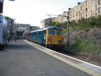 87002 heads the return leg of the 'Electric Scot' railtour through Queens Park on 11th July. When was the last time a class 87 passed through here?<br><br>[Michael Gibb&nbsp;11/07/2009]
