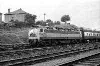 Two tone green Class 47 no 1779 passes Eastfield MPD with an Aberdeen - Queen Street service on the afternoon of 16 September 1972.<br><br>[John McIntyre 16/09/1972]