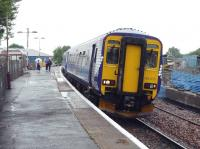 Glasgow bound 156433 awaits its departure time at Stewarton in between showers on 14 July. Evidence of the ongoing building work at the station can be seen in the background.<br> <br><br>[John Steven&nbsp;14/07/2009]