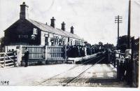 An early postcard showing Grimsargh station, looking towards Preston, on what was possibly the busiest day of its life. The platform is packed with ladies in their finery, presumably waiting for an excursion or special train. The P&L station closed in 1930 but goods trains continued to Longridge until 1967. Although the station site has now been built over it is still possible to walk the old trackbed for a short distance in both directions from here. <br><br>[David Hindle Collection&nbsp;//1909]