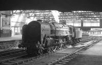 70002 <I>Geoffrey Chaucer</I> simmers beneath the footbridge at Carlisle on 18 April 1964 after arriving light engine from Kingmoor shed. The locomotive is awaiting the 9.25am Crewe - Perth train which it will work north.<br><br>[K A Gray&nbsp;18/04/1964]