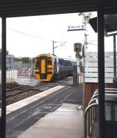 A view from a much needed platform shelter, as 158786 leaves Kingsknowe station in heavy rain on Saturday morning 18 July with the 0825 Edinburgh Waverley - Glasgow Central via Shotts. The 158s are standing in for the regular 156 units on this route, which have been switched to the Glasgow - Girvan <I>Golflink</I> specials during the Open Golf Championship currently being staged at Turnberry. [See image 24635]<br> <br><br>[John Furnevel&nbsp;18/07/2009]
