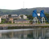 The old Edinburgh & Northern station buildings and a pair of disused cranes, seen from across the dock at Burntisland on 14 June 2009. [Unknown to me at the time the cranes were about to become history and have since vanished.] <br> <br><br>[David Panton&nbsp;14/06/2009]
