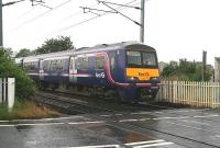 The Saturday morning 0705 Glasgow Central - North Berwick service, formed by unit 322482, runs east over the level crossing into Kingsknowe station on 18 July 2009... and it's still raining... <br><br>[John Furnevel&nbsp;18/07/2009]