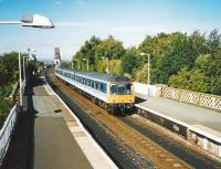 117 311 comes off the Bridge and into Dalmeny with an Edinburgh train in September 1999<br><br>[David Panton&nbsp;/09/1999]