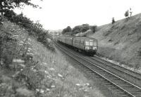 A Largs - Glasgow DMU north of Lochwinnoch (Kilbarchan Loop) in August 1967. The service had been diverted due to permanent way work on the main line.<br><br>[Colin Miller&nbsp;/08/1967]