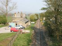 View over Eastgate station (now a private house) in May 2006 looking back along the Weardale branch towards Bishop Auckland. The station, on what was a major mineral branch, lost its passenger service in 1953. The line was cut back from the original Wearhead terminus to the Eastgate Blue Circle cement works (behind camera) by 1968. This part of the line closed in 1993 but, further east, the privately operated Weardale Railway is active.<br><br>[John Furnevel&nbsp;12/05/2006]