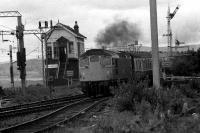 Passing Craigendoran SB, 27042 comes through Craigendoran with a service for Glasgow Queen St from the West Highland line in 1974.<br><br>[John McIntyre&nbsp;//1974]