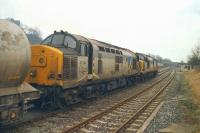 37214 and 37354 head a cement train through Clitheroe south-west towards Blackburn in March 1992. The train had originated from Horrocksford Cement works, accessing the mainline at Horrocksford Jct less than a mile away.<br><br>[John McIntyre&nbsp;31/03/1992]