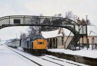 40065 calls at Carrbridge with a southbound train from Inverness on a snowy 22 March 1980.<br><br>[Peter Todd 22/03/1980]