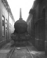 Gresley K3 2-6-0 no 61835 stands between two buildings at Peterborough's New England shed on 7 July 1963 having been rigged as a stationary boiler. The locomotive was officially withdrawn from here on 16 September 1963 and cut up at Doncaster Works the same month.<br> <br><br>[David Pesterfield&nbsp;07/07/1963]