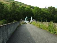 A view along the trackbed of the Edinchip Viaduct north of Balquhidder on the way to Lochearnhead. Being made of metal the original centre span was removed for scrap on closure. The substantial new centre span has given new life to the viaduct as part of a long distance path/cycleway. A plaque on the viaduct relates the unfortunate circumstances of how the funds were raised. <br><br>[John Gray&nbsp;25/07/2009]