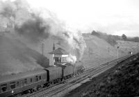 B1 no 61349 climbs away from Tynehead station and past the signal box with a southbound train in April 1964, complete with a horse box marshalled next to the locomotive.<br><br>[Robin Barbour Collection (Courtesy Bruce McCartney)&nbsp;/04/1964]