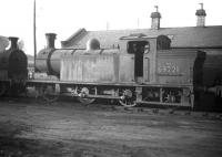 Reid N15 0-6-2T no 69221 stored out of use alongside Dunfermline shed in February 1959.<br><br>[Robin Barbour Collection (Courtesy Bruce McCartney)&nbsp;11/02/1959]